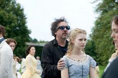 Director Tim Burton and Mia Wasikowska on the set of Alice in Wonderland (2010).