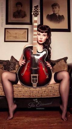 Young girl with victory rolls and electric guitar between her legs #vintage #rockabilly