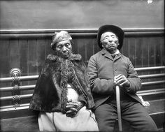 Man and woman, possibly Suquamish, seated inside a Seattle building, ca. 1910, UW Library American Indians of the Pacific Northwest Collection