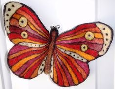 My large needle felted butterfly magnet that spent the summer on my Fibre & Yarn Shops front door.