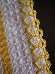she has a tutorial on how to do this.  Not sure if this is crochet or embroidery, but a pretty edging.