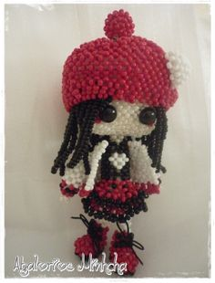 Doll black and red