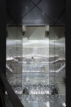 nendo has designed a spectacular kaleidoscopic exhibition for a Sogetsu school of Ikebana in Japan, commemorating it's 90th anniversary.