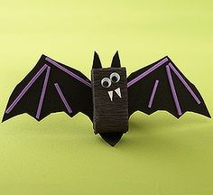 Wrap a box of candy Dots or other treat with black crepe paper. Trace wings & ears on foam for kids to cut out. Add eyes and teeth for a cute bat craft.