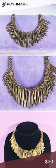 Gold tone tube statement fashion necklace. Here we have this precious gold tone tube layered statement fashion necklace, Long tube metal dangling on a three layered chain, tubes make a rattle chime sound. Very fun fashion statement necklace, perfect for your black or pop of color evening cocktail dress. In great condition, no major damages, no makers Mark. See photos for detail, Vintage Jewelry Necklaces