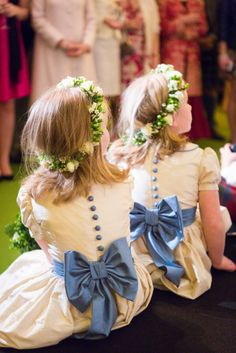 Orissa silk flower girls dresses with Peter Pan collar, cornflower blue bows, sashes, buttons and piping. www.firstlightweddings.co.uk