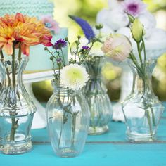 Our set of 4 vintage luncheon vases emit delicate elegance through their petite sizes and pressed glass designs. Each a different style and size, these vessels range from 4 inches to 5.25 inches tall and resemble different designs.
