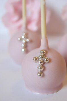 "Beautiful Pink Baptism Cake Pops by ""Evie and Mallow"" cute but when you eat it its an upside down cross..."