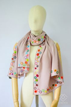 This is an elegant hand-embroidered shawl with colorful dots pattern, uses satin stitch and manually gradation one by one at all four trims, very elaborate and unique.