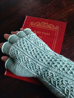 Cool fingerless mitts with twisted stitches and cables.