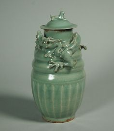 Urn with Dragon and Dog  Period: Southern Song dynasty (1127–1279) Date: 12th–13th century Culture: China Medium: Porcelain with carved and raised decoration under celadon glaze (Longquan ware) Dimensions: H. with cover: 10 in. (25.4 cm)
