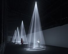 volumetric, explorable forms are composed of beams of projected light.