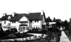 Residence of Frederick Zimmerman at 13514 Lake Ave. Built in 1913, it is the first home in Lakewood built of stucco over brick. The grounds included a large truck garden, orchard, and vineyard. The home included a library and billiard room on the first floor and a ballroom on the third floor. A servant's wing included a a kitchen and pantry on the first floor and bedrooms for the maid, cook, gardener, and handyman on the second floor. The home now has an Edgewater Dr. address. Lakewood Ohio, Large Truck, Billiard Room, Zimmerman, First Home, Second Floor, Maid, Pantry, Vineyard