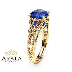 Cushion Cut Sapphire Engagement Ring 14K Yellow Gold Cushion Cut  Ring  Unique Sapphire Engagement Ring by AyalaDiamonds on Etsy https://www.etsy.com/listing/256835248/cushion-cut-sapphire-engagement-ring-14k