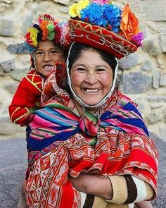 Smile and the world will smile with you. Beautiful expression of joy from a Peruvian mother anddaughter. She is wearing a traditional textile from The Andes Mountains in Cuzco, Peru. Via#pinterest