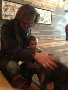 Looks like Thomas might be close to, or is, walking! And also becoming a dog lover like his dad :D