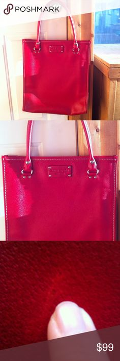 Kate Spade Red Tall Tote Bag Kate Spade Red Tall Tote Bag With Three Inner Pockets Measures approx. 15.5x13.5 Has one small scuff on the back as pictured in pictures 3 & 4, otherwise it is in excellent condition kate spade Bags Totes