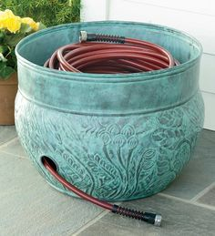 DIY inexpensive hose pot - faux finish plastic pot and drill hole in side(spray with metalic brown spray paint, and dry sponge on turquoise paint)