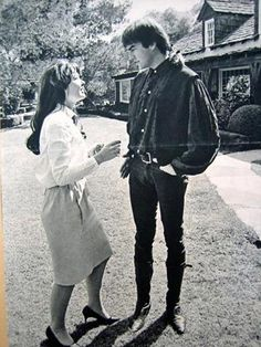 Mark talking to a fan in the yard at the infamous house he owned with Terry Melcher, where two years later Sharon Tate and others were murdered. Very sad to think dead bodies would be lying out there years later.  :(