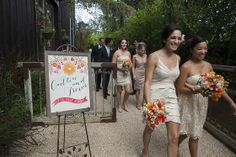 A Bright, Picturesque Wedding in Healdsburg | 7x7 - Caitlin + Trevor. Designed by Lindsey Relyea of l'Relyea Events - champagne bridesmaid dresses, mix and match dresses, bright flowers, colorful welcome sign