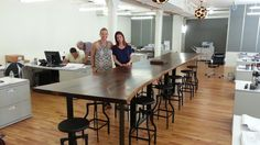 19' long live edge walnut conference table with iron base