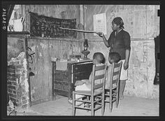 Mother's Day: Mother teaching children, Transylvania, Louisiana, June 1939.  Russell Lee, photographer