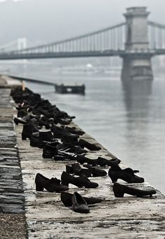 During WWII, Jews in Budapest were brought to the edge of the Danube, ordered to remove their shoes, and shot, falling into the water below. 60 pairs of iron shoes now line the river's bank, a ghostly memorial to the victims. #truth