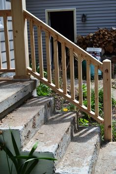 Porch progress and the baby-do list - NewlyWoodwards Progress Pics: Rail for concrete steps Step Railing Outdoor, Porch Step Railing, Porch Handrails, Exterior Stair Railing, Wood Railings For Stairs, Front Porch Steps, Porch Stairs, Balcony Railing Design, Outdoor Stairs