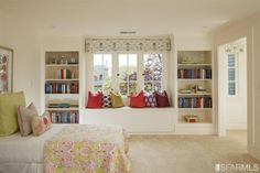 Sweet guest room with built-ins and window seat.
