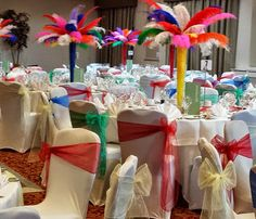 Rio and Carnival themed event décor. Feather table centres, bright sashes and chair covers for hire in London and the UK