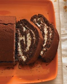 A simple filling of lightly sweetened whipped cream is rolled up in chocolate sponge cake to make this classic dessert.  Serve the cake with raspberry or strawberry sauce if you like.