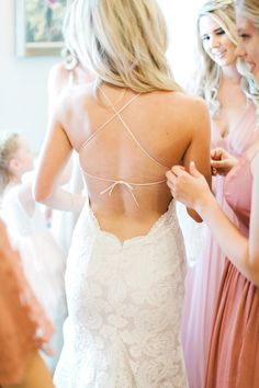 Open back lace wedding gown.  Romantic blush backyard Arizona garden wedding by Pinkerton Photography, Arizona Wedding Photographer.