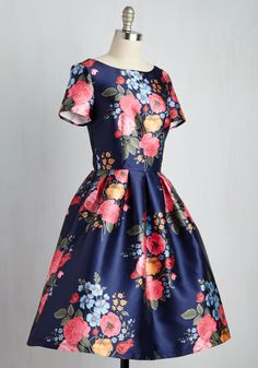 This navy A-line from Chi Chi London was made for sashaying through stunning terraces! A once-in-a-lifetime trip calls for the pink, orange, and blue florals and scoop back of this short-sleeved fit and flare, so that every adventure can be met with the everlasting freshness offered by this woven frock.