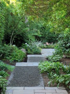 The gravel covering the path leading to the patio is the same color as the bluestone patio. Bands of bluestone have been placed within the pathway, creating continuity and a peaceful transition.   In addition, by laying out the pathway in a yatsuhasi, or Japanese zigzag, pattern, the designer has created a unique and dramatic space.
