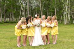 Florida southern barn wedding Bride with bridesmaid yellow and gray www.AmalieOrrangePhotography.com