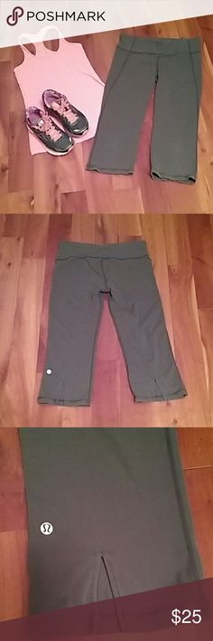 Lululemon  workout capris. Size 10 Grey workout capris by Lululemon.  3 1/2  inch - slit in back of legs. Pair with your favorite tank top and head to the gym!! lululemon athletica Pants Capris