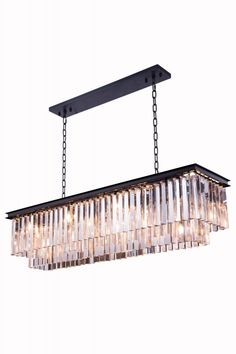 """Sydney Pendent Lamp, Mocha Brown Finish (Royal Cut Crystals). Crystal bars in clear or rich and vibrant hues of gold or silver exploding with prisms layered in circular or rectangular shapes. The Sydney will satisfy your desire to hold the past and embrace the future at the same time.Specifications:   Dimensions 50"""" L x 14"""" W x 18"""" H   Finish Mocha Brown    Crystal Trim  Royal Cut    Crystal Color  Crystal (Clear)    Chain/Wire Included  5 ft./8 ft.    Light Bulbs  12    Bulb Type  E12…"""