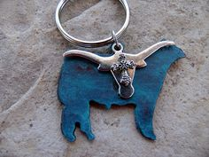 Ths keychain is the perfect accessory for the FFA student, rancher or cowgirl. A special yet inexpensive one of a kind gift.  Click here to see more western jewelry by Whipporwill Valley:  https://www.etsy.com/shop/WhippoorwillValley?ref=hdr_shop_menu&section_id=15079126