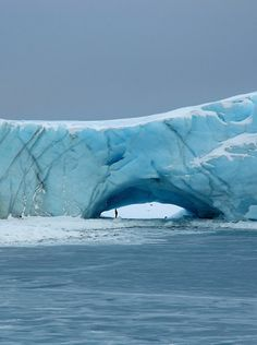 A natural arch in a glacier at Norsal Point, Anvers Island, Antarctica