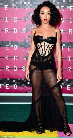 British bombshells: Rita Ora (L) and FKA Twigs (in Atelier Versace) were feeling daring is risque black gowns
