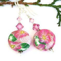 Looking as if they are fresh picked, the SPRING BEAUTY handmade dangle earrings are beautiful choices for spring and summer wear.  The focal of the lovely earrings are individually artisan made pink f