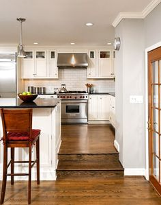Cabinet on both sides of step - Classic Kitchen - traditional - kitchen - dc metro - Harry Braswell Inc.