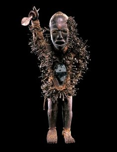 Central African power figures are the collaborative creations of Kongo sculptors and ritual specialists, or nganga. The sculptural representation produced by the carver is conceived as a receptacle to house a specific mystical force that is drawn to the work by the nganga through the addition of ingredients introduced into an abdominal cavity.The figure's posture and gesture, leaning forward with one hand placed on the hip and the other arm brandishing a spear, is the aggressive attitude of…