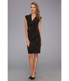 A beauty on every body.. Figure-friendly dress features a shirred wrap-style front that drapes fro...