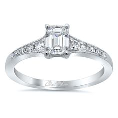 Sparkly and elegant with a bit of antique flair, this milgrained solitaire engagement ring setting is a wonderful, effortless expression of love.