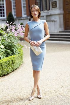 Gorgeous neckline:  Ella Catliff, La Petite Anglaise, in Roland Mouret powder blue dress