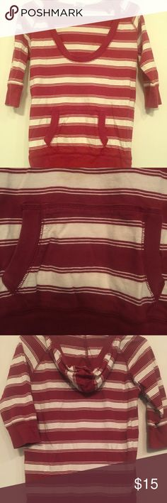 Maurices 3/4 sleeve hoodie shirt-size medium Brick Red and White striped 3/4 sleeve hoodie shirt. Hoodie pocket in front as well. Preowned but in good condition. Small stain on back of hoodie see picture. T-shirt material. 100% cotton shirt Maurices Tops Sweatshirts & Hoodies