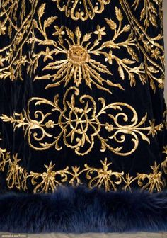 Sapphire blue velvet w/ heavy gold 3-dimensional floral & vine embroidered front & back, V-neck, blue dyed fox fur collar & hem trim