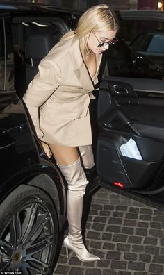 Toned:The 20-year-old model, who has turned heads in New York and London as well as Milan this Fashion Week season, put on a leggy display in racy pearl thigh-high silk boots, which flaunted her slender pins