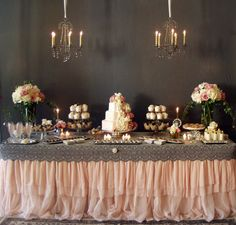 I like the table cloth how it has ruffles and lace! Maybe have a gold ruffle table cloth and then use doilies, spray paint them metallic gold or keep white to use as the top part trimming the table? Then have confetti on the top? Just an idea.
